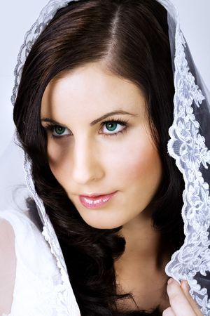 Beautiful young bride with veil over her head Stock Photo - 3653854
