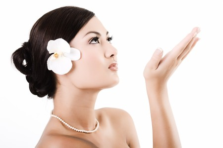 Attractive asian female relaxing after beauty therapy photo