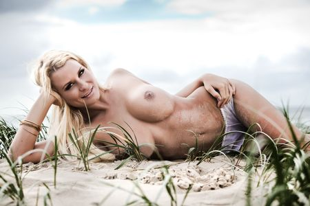beach breast: Sexy topless girl with great tan on the sandy beach