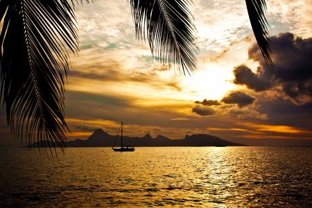polynesia: Dramatic sunset over Moorea Island seen from Tahiti Stock Photo