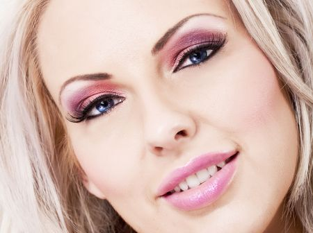 Beautiful blonde woman with pink makeup and large lips photo