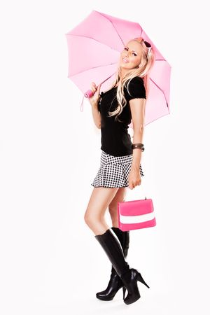 mini umbrella: Young slim sexy pin-up woman in leather boots and short skirt