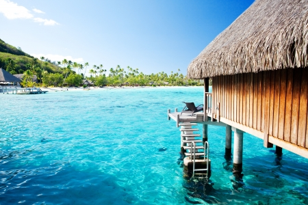 Over water bungalow with steps into amazing blue lagoon