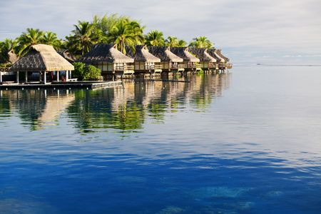 bora bora: Amazing tropical resort with huts over blue water Editorial