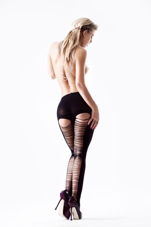 Young topless woman in black stockings from behind Stock Photo - 6102086