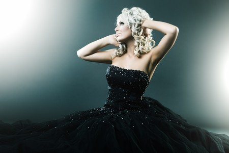 High fashion woman in sexy pose and  large formal dress photo