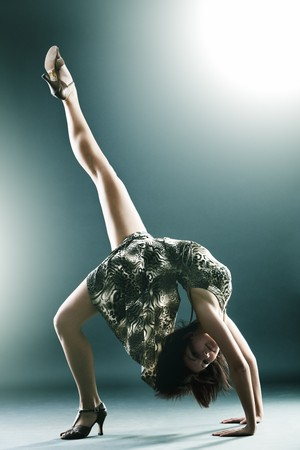 Stylish and young modern style dancer is stretching photo