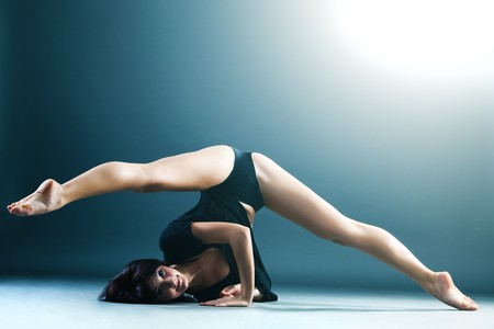 flexible: Young contemporary female dancer doing splits in the air Stock Photo