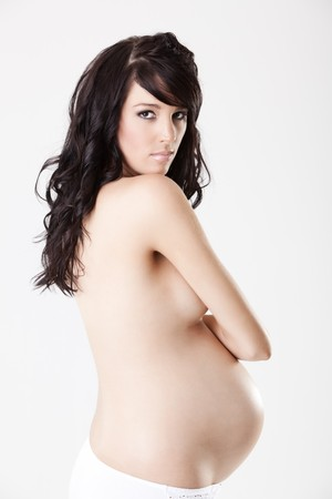 Close up of a nude pregnant body from profile isolated Stock Photo - 6965685