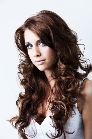 Portrait of beautiful woman with blue eyes and long curly hair photo