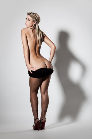 Slim nude woman with great butt in heals photo