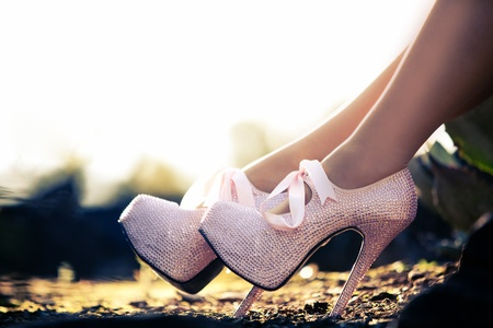 Close up of a pink high heels with little diamons photo