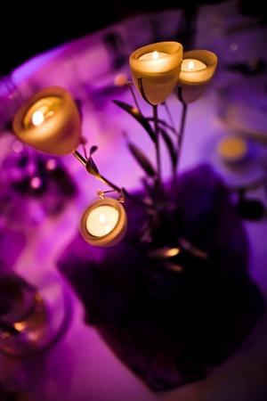 candle light dinner: Romantic centerpiece with candles selective focus Stock Photo
