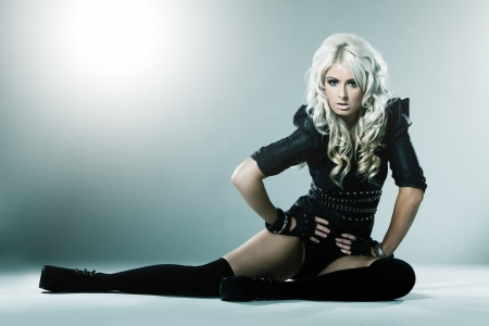 high fashion: Young blonde in attractive high fashion black clothes with stockings