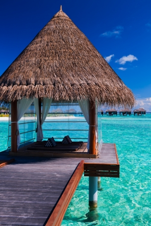 bora bora: Overwater spa and bungalows in tropical blue lagoon