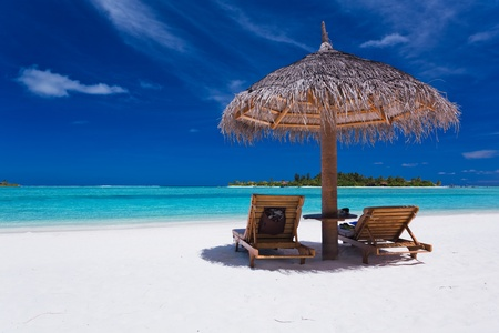 maldives beach: Two chairs and umbrella on stunning tropical beach