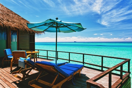bungalows: Overwater villa balcony overlooking green tropical lagoon