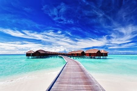 Overwater villas on the tropical lagoon in Maldives