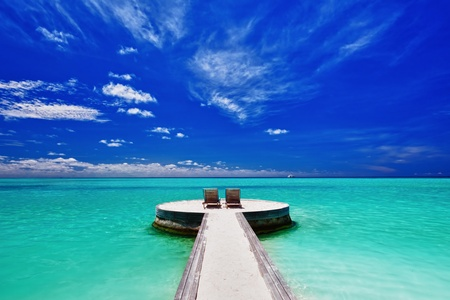 Two deck chairs on stunning empty tropical beach (maldives,\ beach, resort)