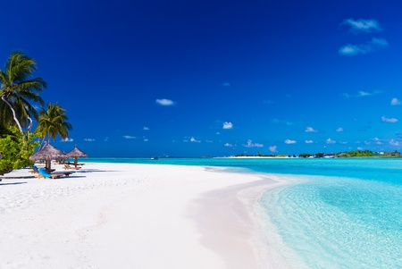 Palm trees over stunning lagoon and white sandy beach Stock fotó