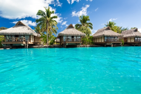 Over water bungalows with steps into amazing blue lagoon