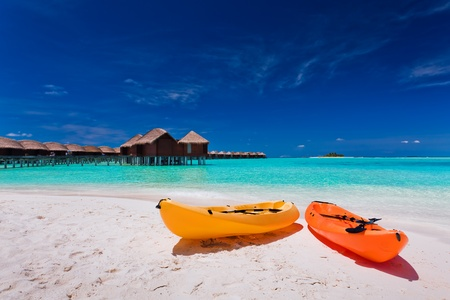 Two colourful kayaks on the tropical beach