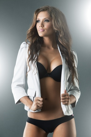 Gorgeous sexy woman in black lingerie and white jacket