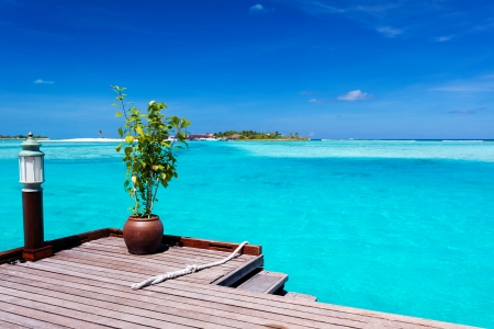 Jetty with amazing ocean view on tropical island photo