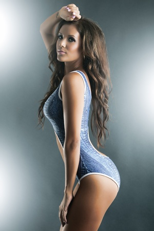Profile of a gorgeous woman in blue one piece bikini Standard-Bild