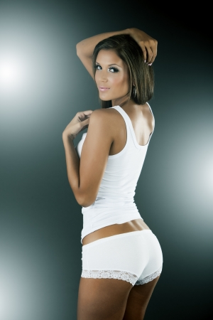 but: Sexy woman wearing white tank top and panties from behind Stock Photo
