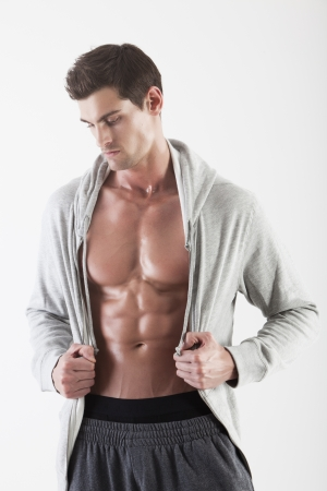 male torso: Portrait of a muscle man posing in studio isolated