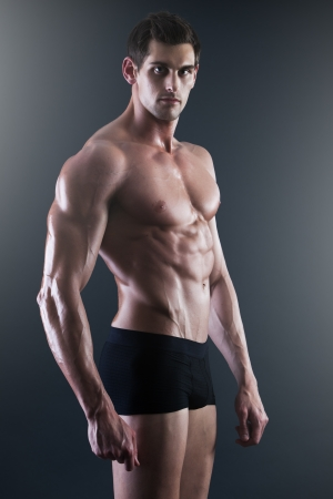 naked abs: Portrait of a young sexy shirtless muscular man in underwear Stock Photo