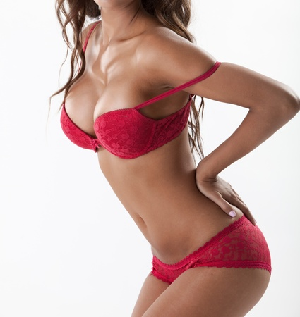 sexy breasts: Sexy brunette with large breasts in red lingerie, side view Stock Photo