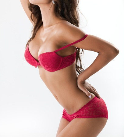 Sexy woman in red lingerie, side view photo
