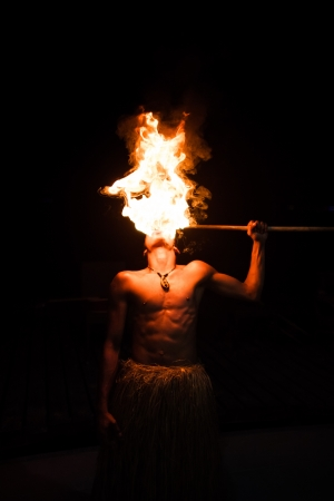 fire show: Man demonstrates the fire breathing portion of their act