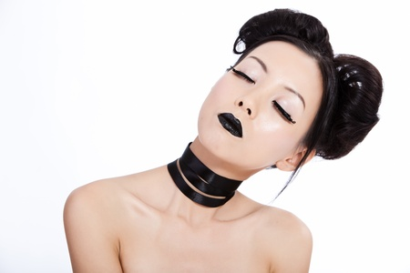 Young asian female with creative black makeup photo