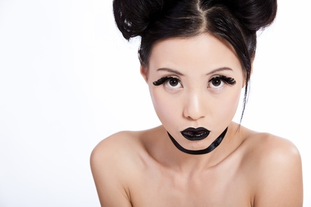 Young asian female with creative black makeup looking photo