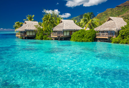 moorea: Overwater villas in tropical lagoon of Moorea Island
