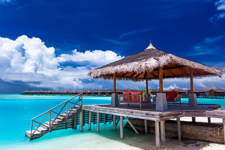 Boat jetty with steps into water on a tropical island of Maldives
