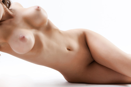 Sexy young nude female with large breasts isolated Stock Photo