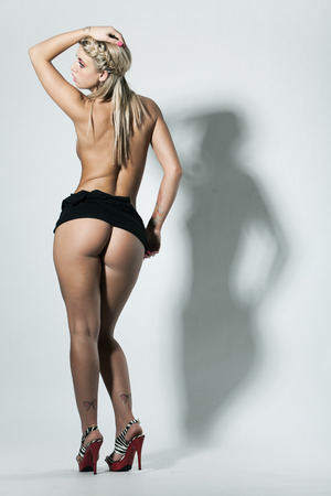 Slim nude woman with great bottom in heals photo