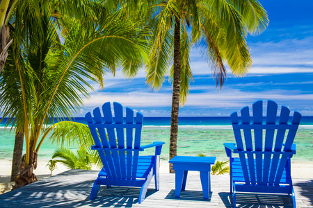 island: Two blue chairs on a beach front on amazing beach, Cook Islands