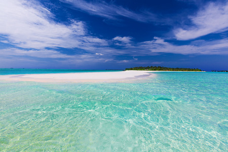 pristine: Long sand bar at the end of tropical island with pristine water