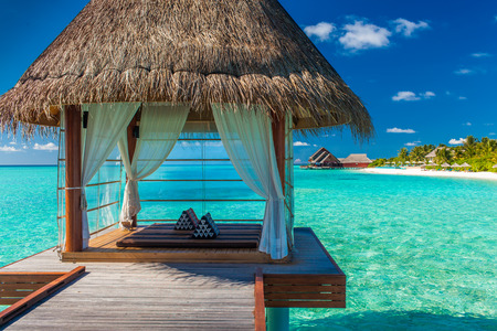 Romantic and luxurious overwater spa with panoramic tropical lagoon view
