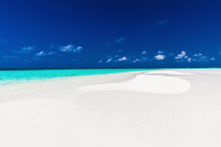 sandbar: Small empty sandbar in the middle of tropical lagoon in atoll of Maldives