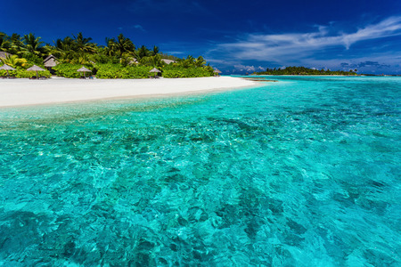 resort beach: The best snorkeling location on the main resort beach in Maldives