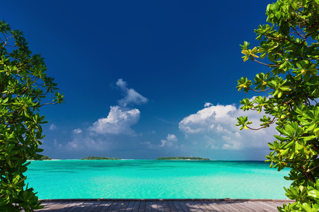 Deserted Tropical Beach Lagoon Framed By Palm Trees Stock Photo ...