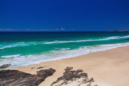 gold coast: Tropical beach with surf waves on Gold Coast, Queensland, Australia Stock Photo