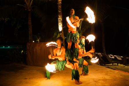 'koh samui': Koh Samui, Thailand - August 24, 2013: Three strong men performing traditional fire dance at tropical resort on Koh Samui Island.