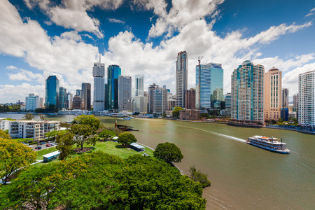 residential building: BRISBANE, AUS - NOV 13 2015: Panoramic view of Brisbane Skyline and Kookaburra Queen ship. Brisbane is Australias third largest city, capital of Queensland. Editorial